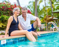 Couple Sitting near Outdoor Pool