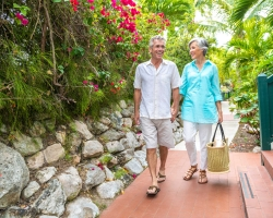 Couple walking outside hotel in gardens
